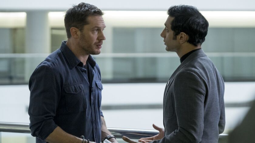 """This image released by Sony Pictures shows Tom Hardy, left, and Riz Ahmed in a scene from """"Venom."""" ("""