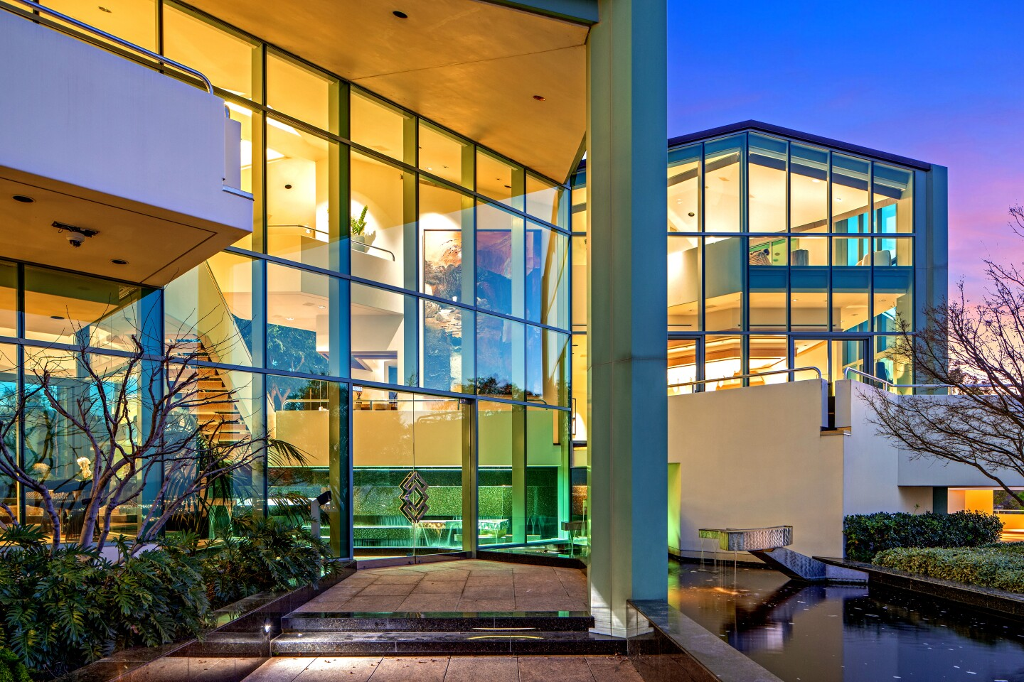 Grammy-winning artists Pharrell is asking $16.95 million for the ultra-modern compound he bought two years ago from filmmaker Tyler Perry. Set on four acres in the Beverly Hills Post Office area, the glass mansion dazzles with its pyramid-shaped skylights, angled walls ands steel beams. At the heart of the house is an atrium-like common area that features a reflecting pool, a great room and a dining room with a crystal rock chandelier.