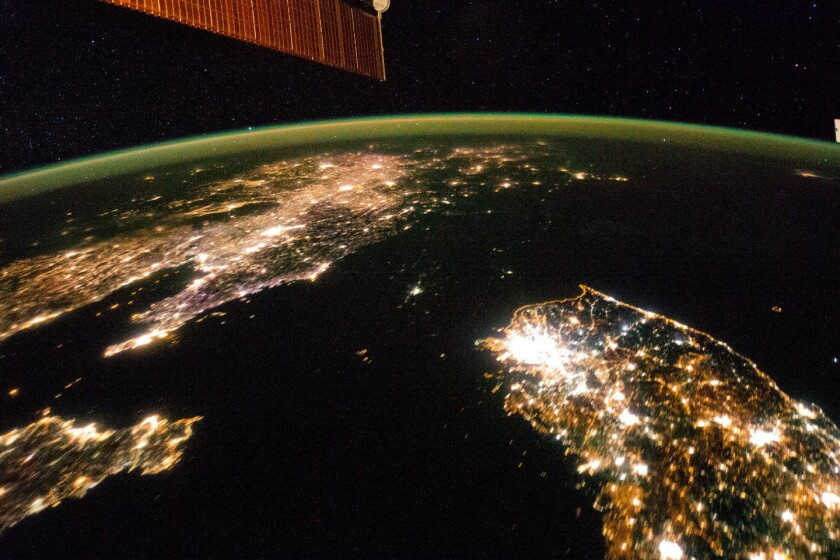 North Korea is a dark patch in this image snapped from the International Space Station.