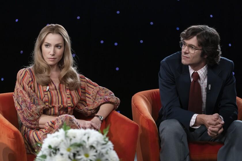 """Ari Graynor as Brenda Feigen Fasteau and Adam Brody as Marc Feigen Fasteau in """"Mrs. America."""""""