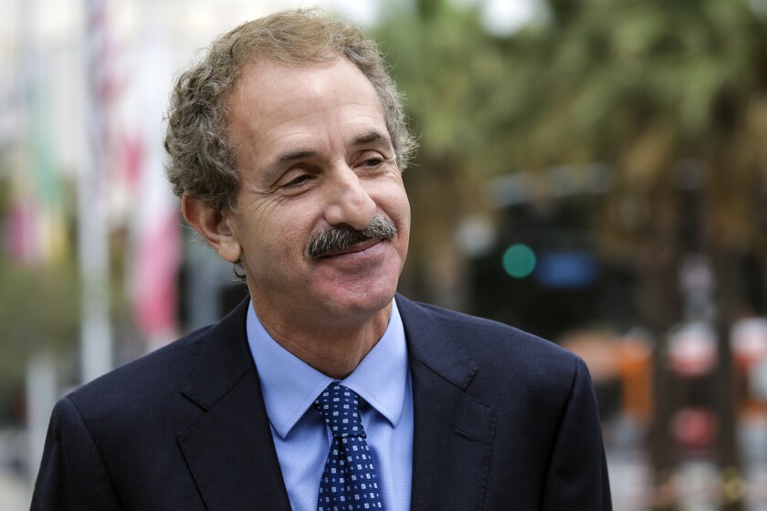 By Atty.  Mike Feuer at a press conference in August outside LAPD headquarters.