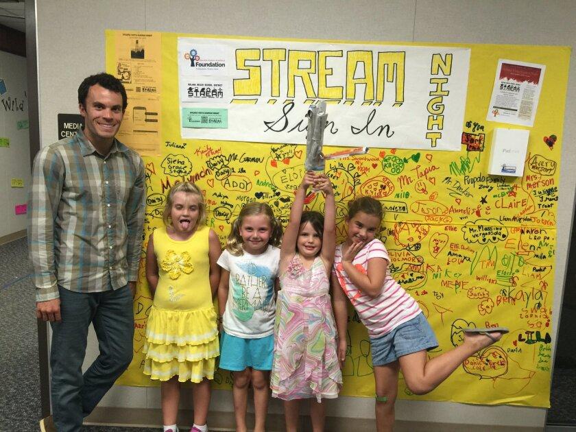 Teacher Taylor Lynch with students. Courtesy photo