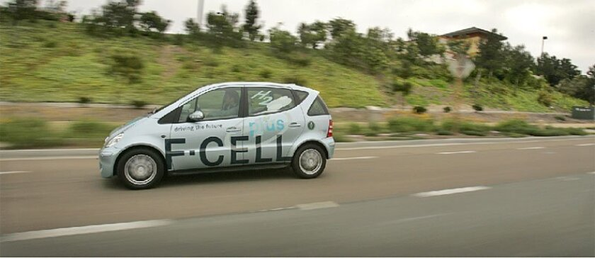 The Mercedes F-cell concept car, powered by hydrogen-fuel-cell technology, traveled along Olympic Parkway in Chula Vista yesterday on the first leg of a 1,700-mile, 28-city West Coast promotional tour. (Howard Lipin / Union-Tribune)