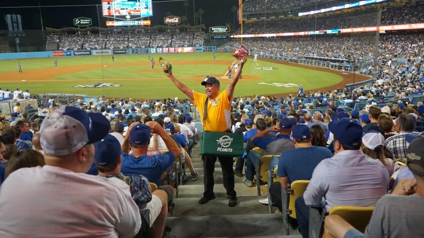 Robert E. Sanchez sells peanuts and Cracker Jack during the 2017 National League Division Series at Dodger Stadium.