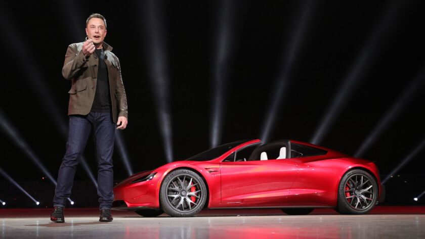 Elon Musk unveils a new Tesla sports car in November 2017. Thousands of buyers are still waiting for delivery of their Model 3 sedans.
