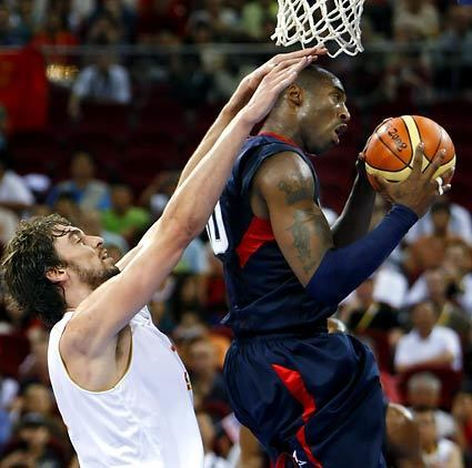 Can Kobe Bryant feel the pressure from Spain's Pau Gasol? Back in the States, the two are teammates for the NBA Lakers.