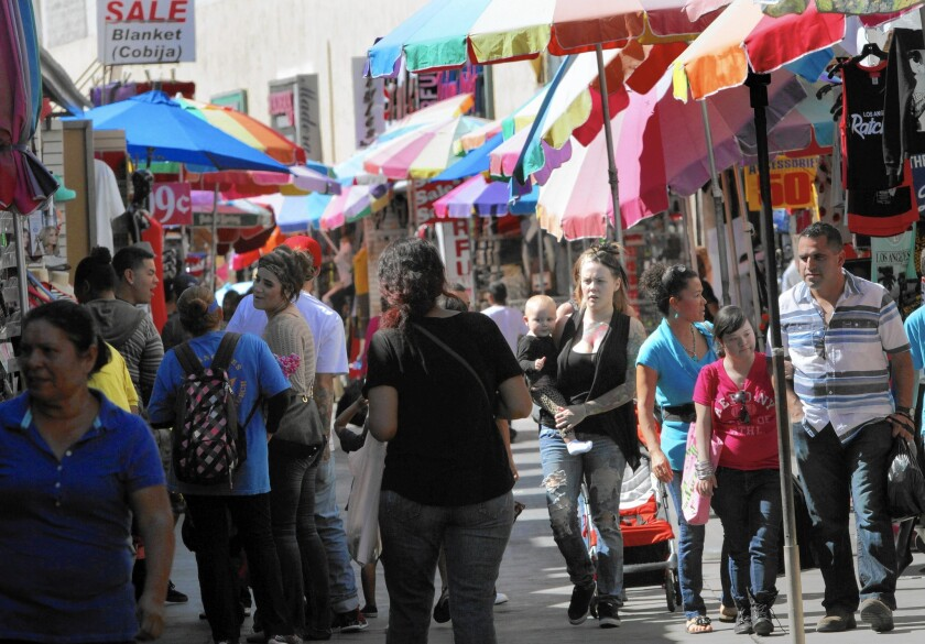 Shoppers search for deals along Santee Alley. Investigators found that 1,549 local garment workers were owed more than $3 million in unpaid wages -- an average of $1,900 per laborer.