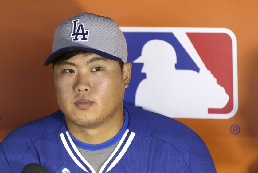 Dodgers starting pitcher Hyun-Jin Ryu addresses the media before a game Saturday in Miami.