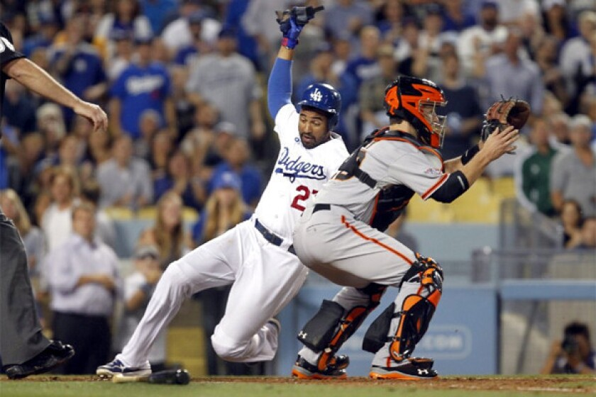 Matt Kemp scores on a Mark Ellis single during the Dodgers' 6-5 victory over the San Francisco Giants in the center fielder's return to the lineup from the disabled list.
