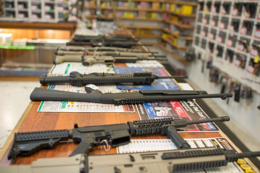 Guns are on display at Roseburg Gun Shop in Roseburg, Ore., on Oct. 2.