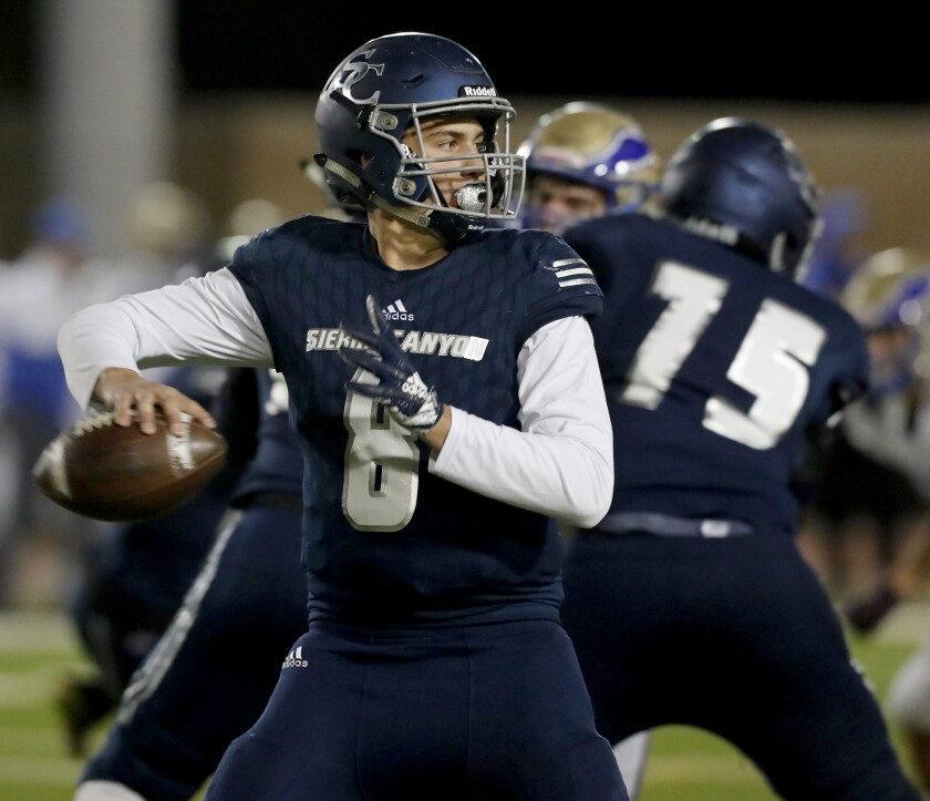 Sierra Canyon quarterback Chayden Peery looks for an open man against Rancho Santa Margarita on Nov. 8, 2019.