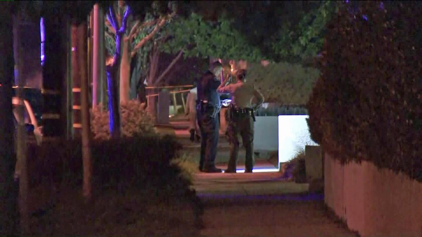 Police investigate after two people were shot and killed in Alhambra