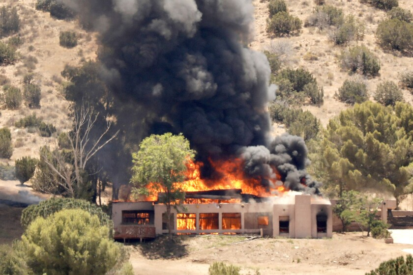ACTON CA JUNE 1, 2021 - A home burns in the 2600 block of W Bent Spur Drive in Acton on Tuesday, June 1, 2021. It is believed this incident is related to a shooting at nearby L.A. County Fire Station 81 in Augua Dulce, where one firefighter was killed and another wounded. (Al Seib / Los Angeles Times)