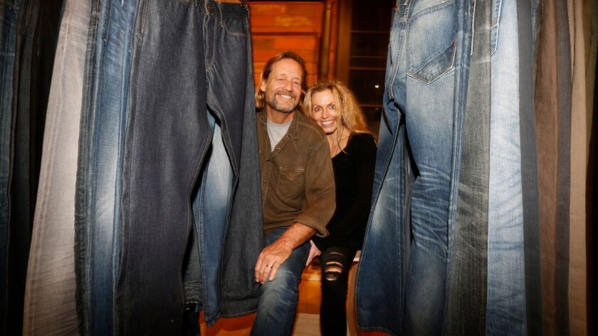 """Jim and Marie Shaffer are surrounded by denim jeans at their store, """"Hail Mary,"""" in Santa Monica."""