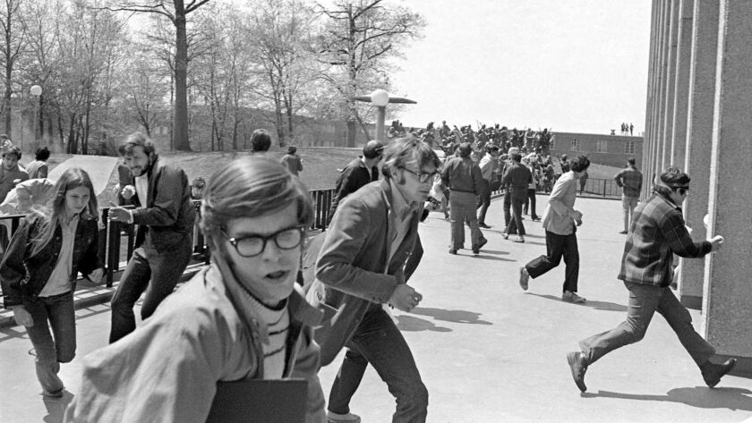 National Guardsmen open fire on students, some of whom are fleeing for cover into Taylor Hall May 4,