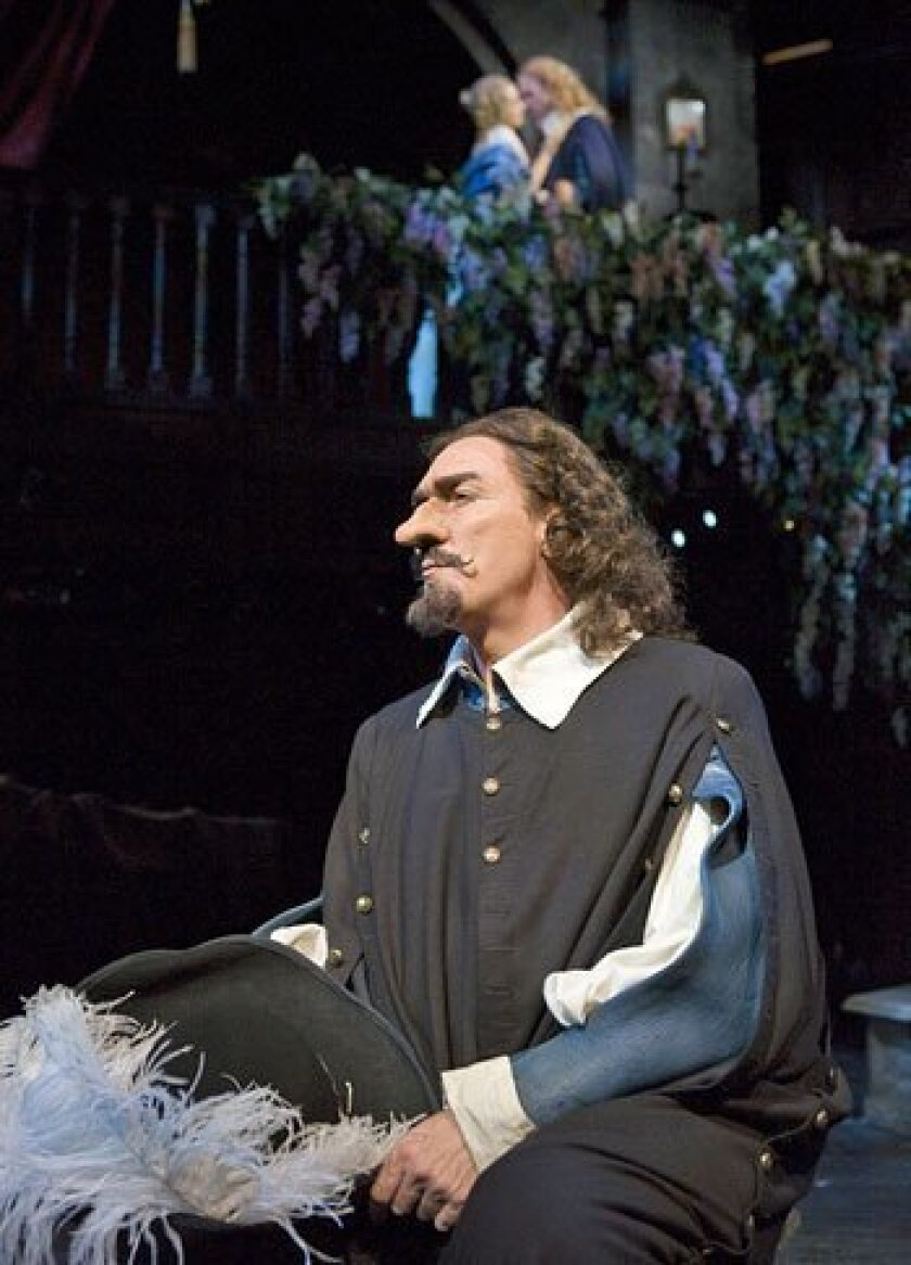 "Patrick Page in the title role of the Old Globe's production of ""Cyrano de Bergerac"" (in background are Dana Green and Brendan Griffin). (Craig Schwartz photo)"