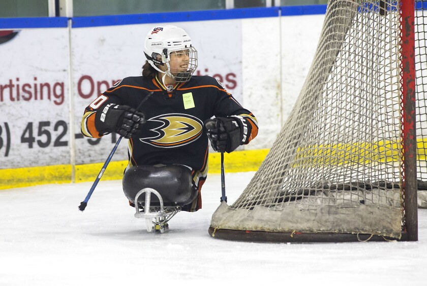Lera Doederlein smiles while taking part in San Diego Ducks sled hockey practice.