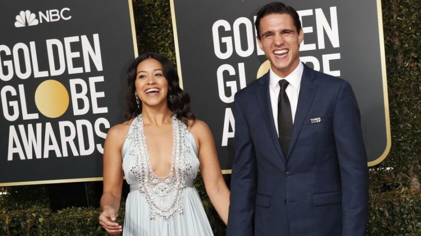 BEVERLY HILLS, CA-JANUARY 06: Joe Locicero and Gina Rodriguez arriving at the 76th Golden Globes a