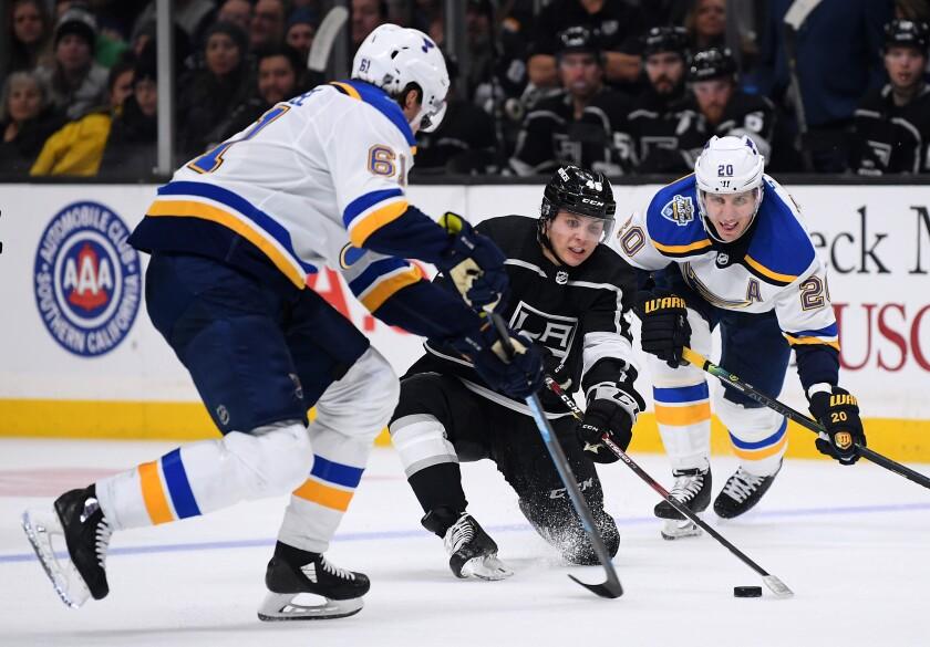 Kings forward Blake Lizotte tries to control the puck.