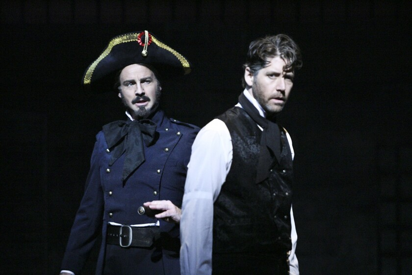 """Randall Dodge, left, and James Barbour star in """"Les Misérables' at La Mirada Theatre for the Performing Arts."""