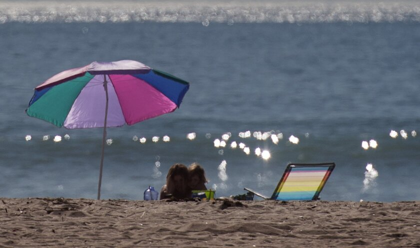 Sitting on local beaches is now allowed in San Diego County.