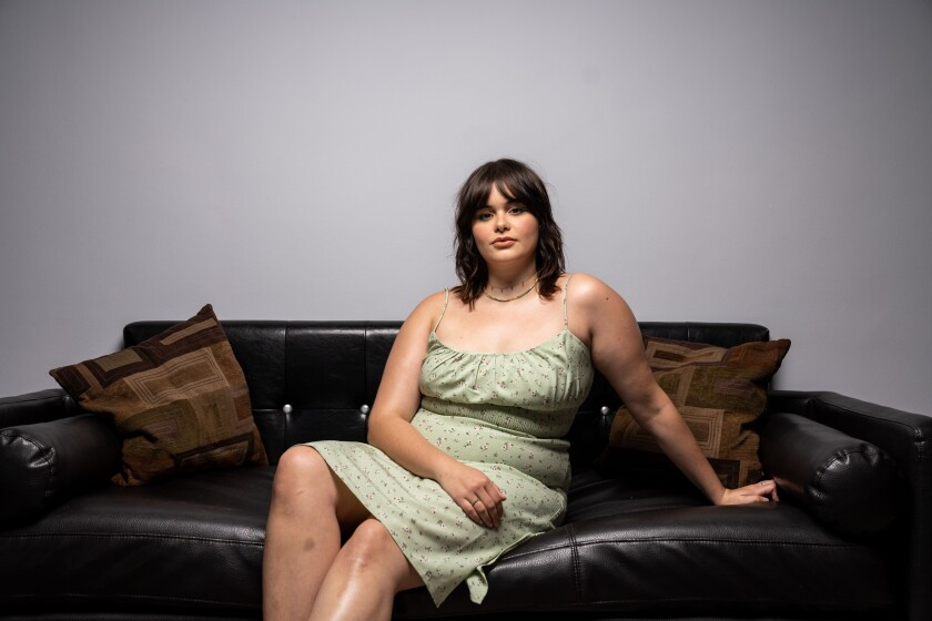 "Ferreira, seen sitting on a sofa, began her career as a plus-size model before being cast on ""Euphoria."""