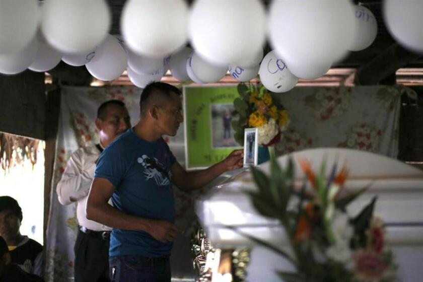 Neighbors attend the Dec. 24, 2018, wake in San Antonio Secortez, Guatemala, for Jakelin Caal, the 7-year-old girl who died in early December while in US government custody after crossing illegally into the US from Mexico. EFE-EPA/Edwin Bercian