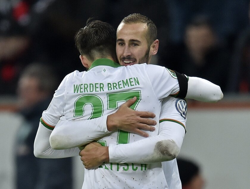 Bremen's Florian Grillitsch, in front, celebrates with Bremen's Alejandro Galvez after scoring their third goal during the  German Soccer Cup quarterfinal  match between Bayer Leverkusen and Werder Bremen in Leverkusen, Germany, Tuesday, Feb. 9, 2016. Leverkusen was defeated by Bremen with 1-3. (AP