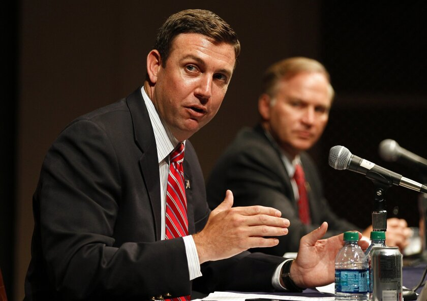 Reps. Duncan Hunter, left, and Randy Forbes conduct a forum on defense cuts in June 2012 at the University of San Diego. K.C. Alfred • U-T