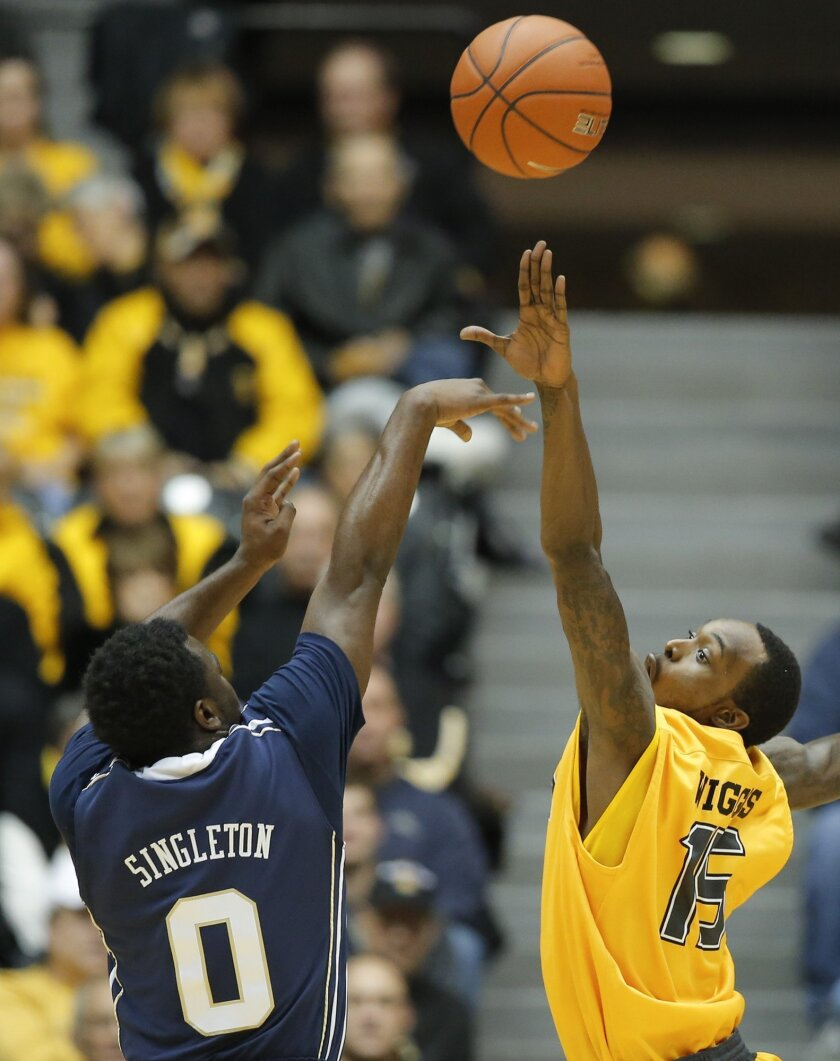 Wichita State's Nick Wiggins tries to block the shot of Oral Roberts' Jabbar Singleton during the first half of their game in Wichita, Kan. on Saturday, Dec. 7, 2013. (AP Photo/The Wichita Eagle, Travis Heying) LCOAL TV OUT; MAGS OUT; LOCAL RADIO OUT; LOCAL INTERNET OUT
