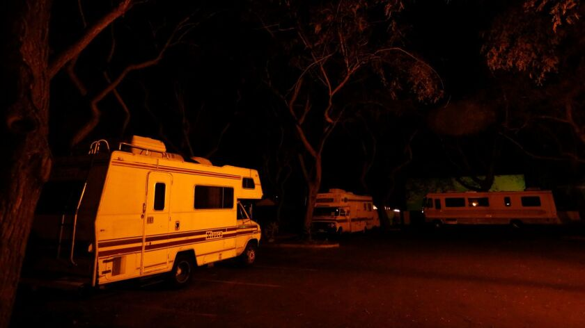 Homeless people who live in camper trailers park in one of 20 lots available to them through the New Beginnings Safe Parking Program in Santa Barbara on March 6, 2016.