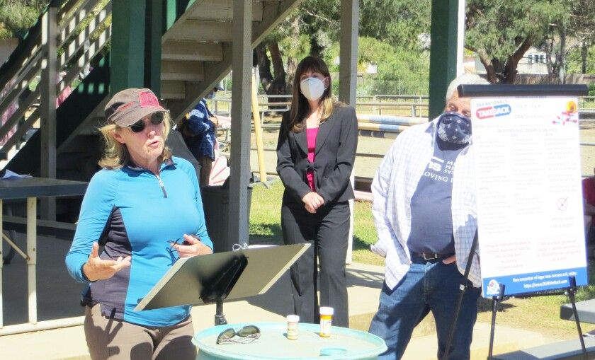 Poway Valley Riders Association board member Sam Miller speaks, while Cindy Cipriani and Ron Stark look on.