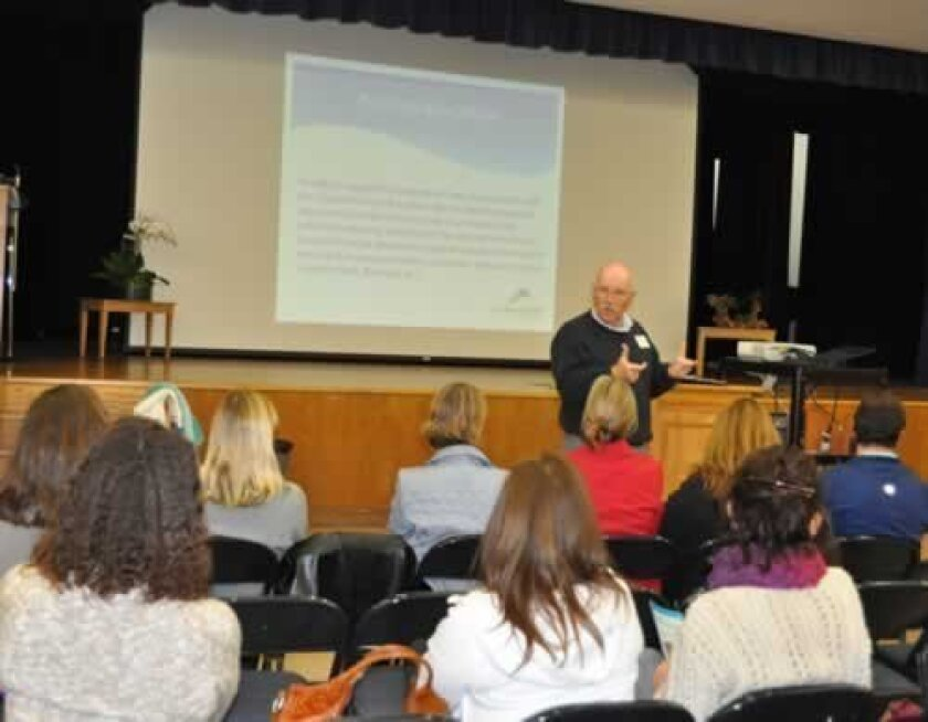 Retired area superintendent, principal and teacher Mike Price discusses changes to district policies that would give La Jolla schools greater autonomy at a recent town hall meeting at Muirlands Middle School held by the La Jolla Cluster Association. Photos Catherine Ivey lee