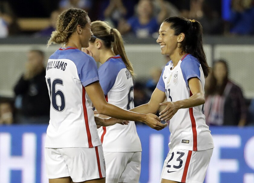 United States forward Christen Press, right, celebrates her goal with teammate Lynn Williams (16) during the first half of an exhibition match against Romania in San Jose on Nov. 10.