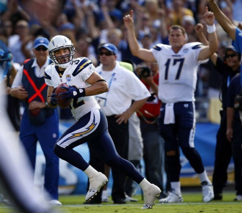 Chargers Eric Weddle runs back a 4th quarter interception for a touchdown against Miami. Philip Rivers cheers him on.