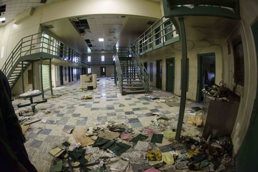 Debris litters the floor in housing unit 2 during a tour of the Tecumseh State Correctional Institution in Tecumseh, Neb., Tuesday, May 19, 2015. The tour took place a little more than a week after a riot at the prison left two inmates dead. (AP Photo/Nati Harnik)