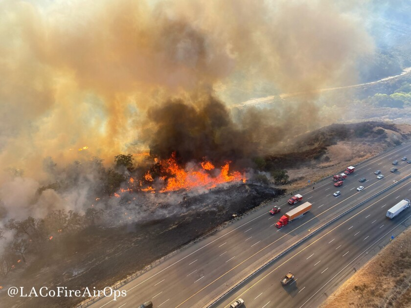 An aerial photo shows a wildfire off Interstate 5 north of Castaic on Saturday.