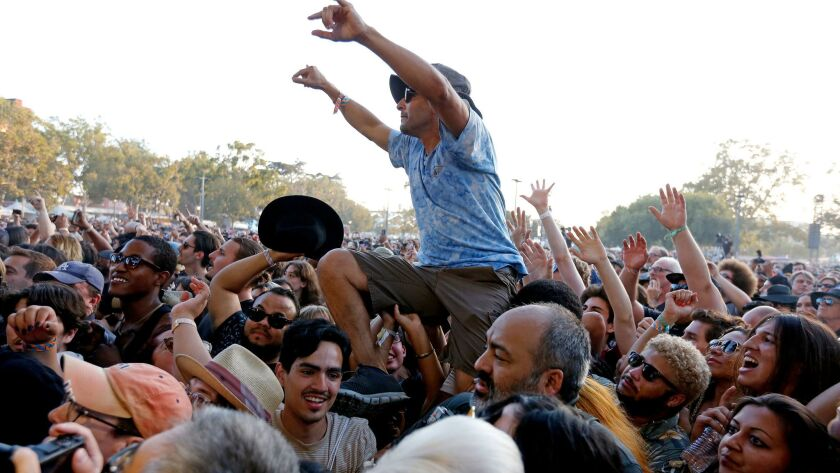 A fan crowd surfs at the 2017 edition of FYF Fest.