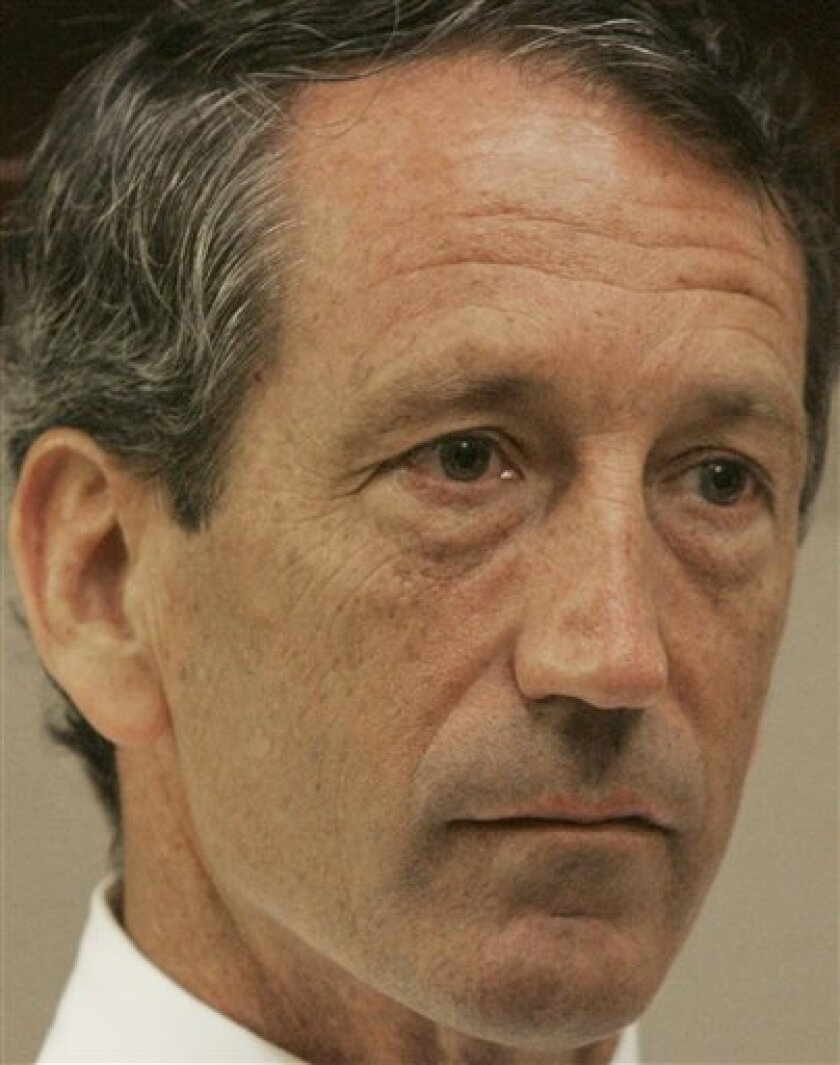 """South Carolina Gov. Mark Sanford talks during an interview with The Associated Press about his relationship with an Argentine mistress,  in his Columbia, S.C., Statehouse office on Tuesday, June 30, 2009. During the interview Sanford said that he """"crossed lines"""" with a handful of women other than h"""