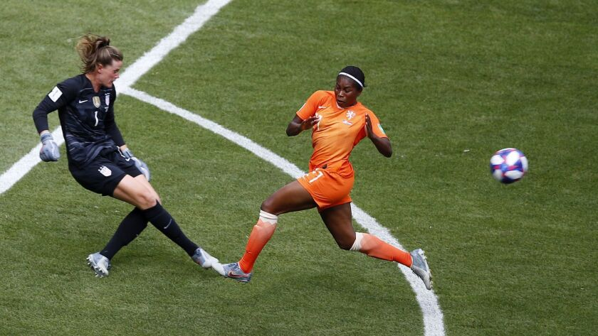 U.S. goalkeeper Alyssa Naeher, left, runs out of the goal box to kick the ball away from Netherlands forward Lineth Beerensteyn during the first half of the Women's World Cup final in Lyon, France, on Sunday.