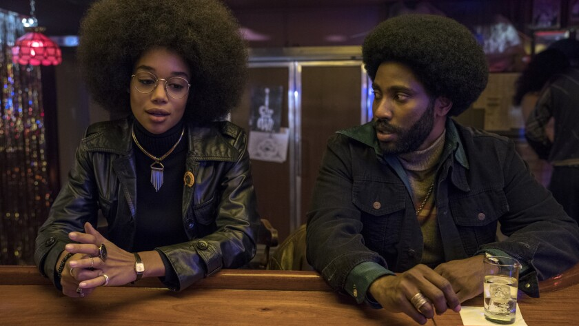 "Laura Harrier and John David Washington in ""BlacKkKlansman."""
