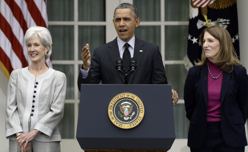 President Obama is shown in April, flanked by outgoing Health and Human Services Secretary Kathleen Sebelius, left, and Sylvia Mathews Burwell, who was confirmed June 5 to replace Sebelius.