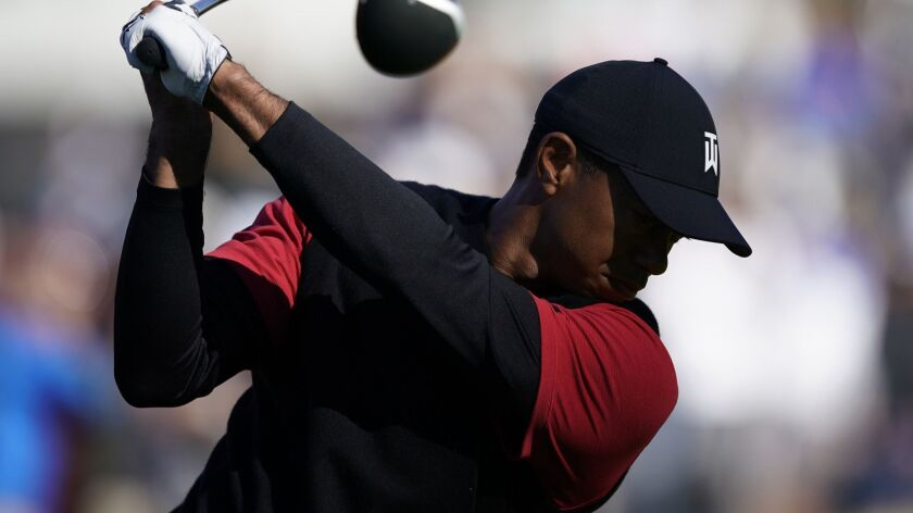 Tiger Woods tees off on the ninth hole as third round play continues during the Genesis Open golf to
