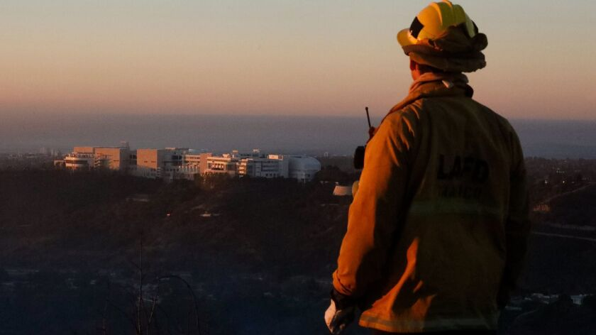 BEL AIR - DECEMBER 7, 2017 -- Firefighter Bobby D'Amico looks out over the Getty Center while monito