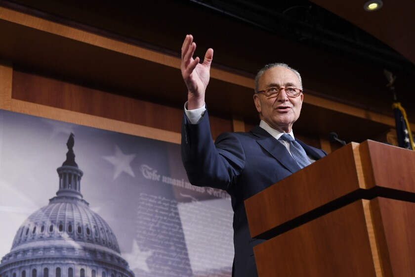 Senate Minority Leader Sen. Chuck Schumer (D-N.Y.) speaks during a news conference on Capitol Hill in Washington on Wednesday following a vote in the Senate to acquit President Trump on both articles of impeachment.