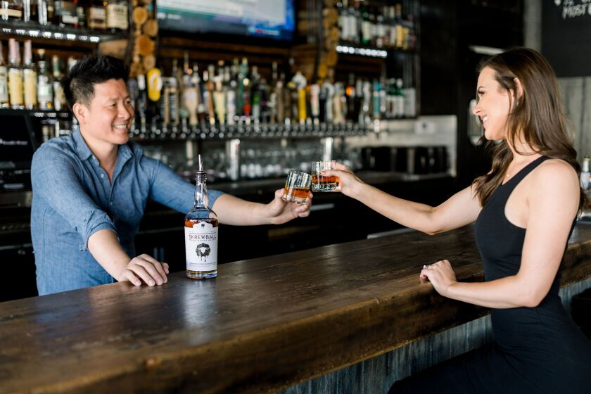 Skrewball Whiskey co-founder Steve Yeng of Ocean Beach, photographed by the Union-Tribune for a profile article in 2018, has announced the company's pledge of up to $500,000 to help laid-off bar workers.