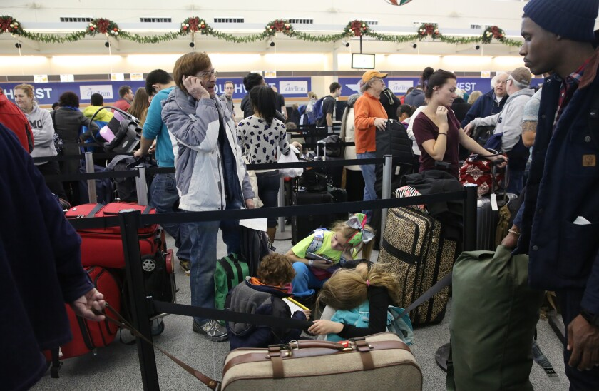 Travelers waiting in line at a Southwest Airlines counter in Midway Airport last month on a day that Southwest canceled many flights because of bad weather.