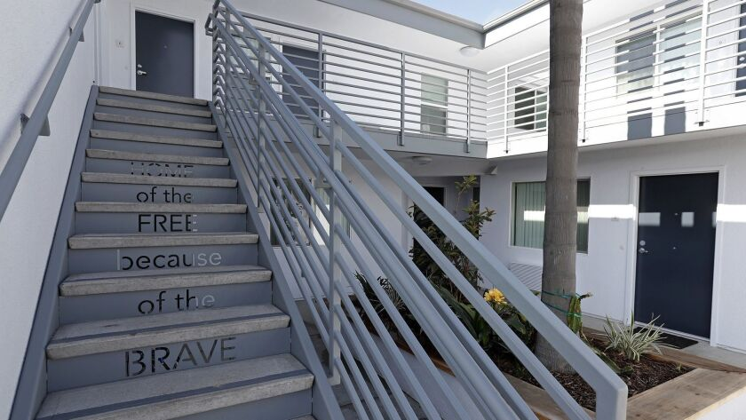 "The words ""Home of the FREE because of the BRAVE"" are inscribed into a stairway at The Cove Apartmen"
