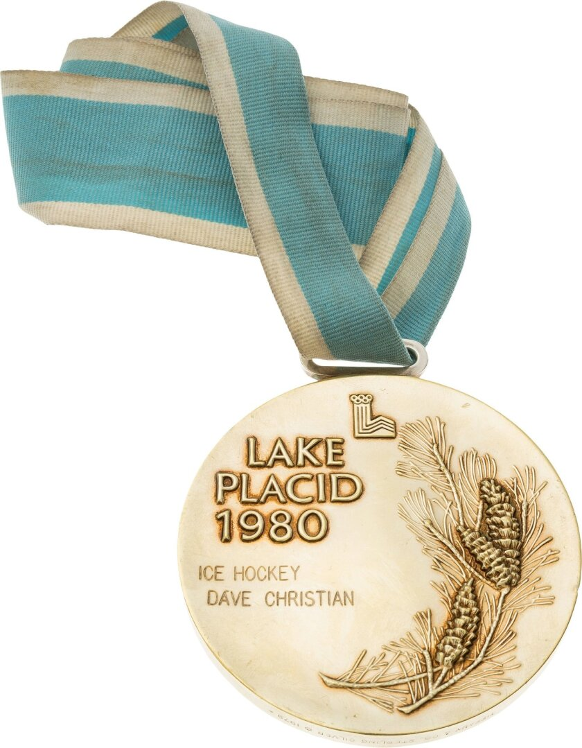 This handout provided by Heritage Auctions shows the 1980 Olympic Gold medal presented to U.S. hockey player Dave Christian. Father and son Bill Christian and Dave Christian have put their Olympic gold medals, among many other items, up for auction this month. The memorabilia is valuable, but the m