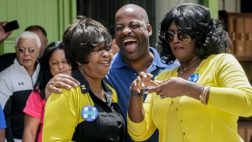 State Sen. Isadore Hall, center, at the opening of the Hillary for California office in South Los Angeles on May 14.